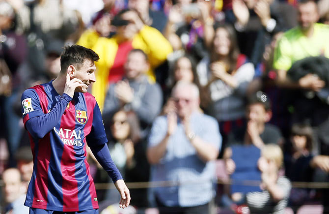 Barcelona's Lionel Messi celebrates a goal against Rayo Vallecano during their La Liga match at Camp Nou stadium in Barcelona on Sunday