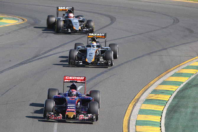 Max Verstappen of Netherlands and Scuderia Toro Rosso drives ahead of Sergio Perez of Mexico and Force India and Nico Hulkenberg of Germany and Force India