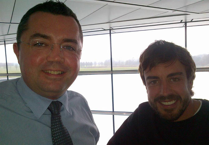 Fernando Alonso (right) with a McLaren official on Wednesday