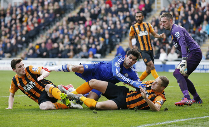 Chelsea's Diego Costa in action with Hull City's Allan McGregor, Andrew Robertson and Michael Dawson