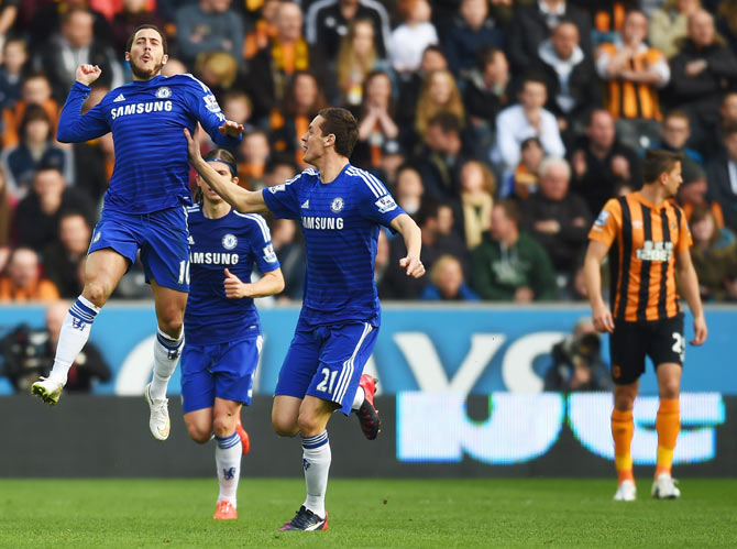 Eden Hazard of Chelsea (10) celebrates with Nemanja Matic (21) as he scores their first goal against Hull on Sunday