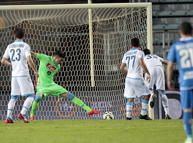 Raul Albiol of SSC Napoli scores own goal