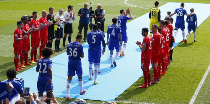Liverpool players form a guard of honour as Barclays Premier League Champions Chelsea come out