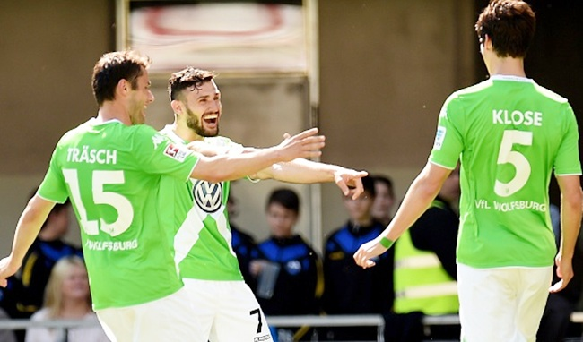 Wolfsburg's Christian Traesch and Daniel Caligiuri celebrate