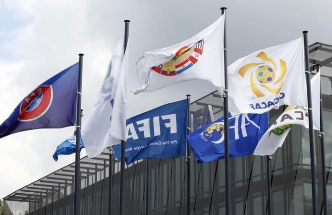 Flags are pictured in front of the headquarters of soccer's international governing body FIFA in Zurich