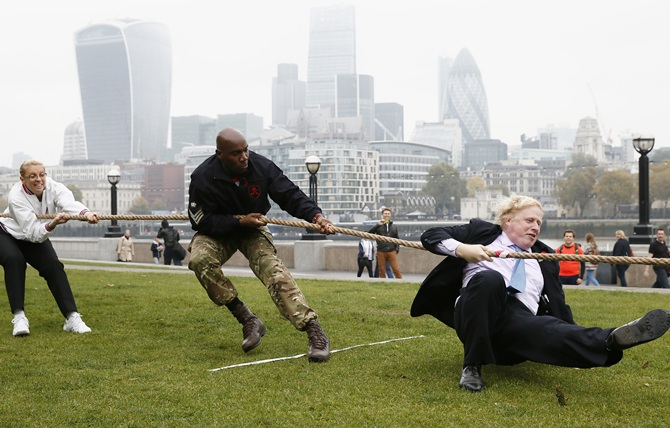 London Mayor Boris Johnson takes part in a tug of war