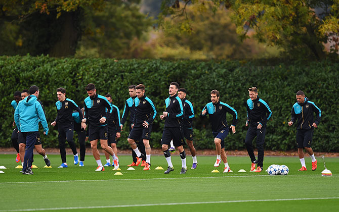 Arsenal players warm up during a training session ahead of the UEFA Champions League match against Bayern Munich