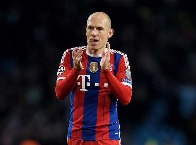 Arjen Robben of Bayern Muenchen applauds the travelling fans