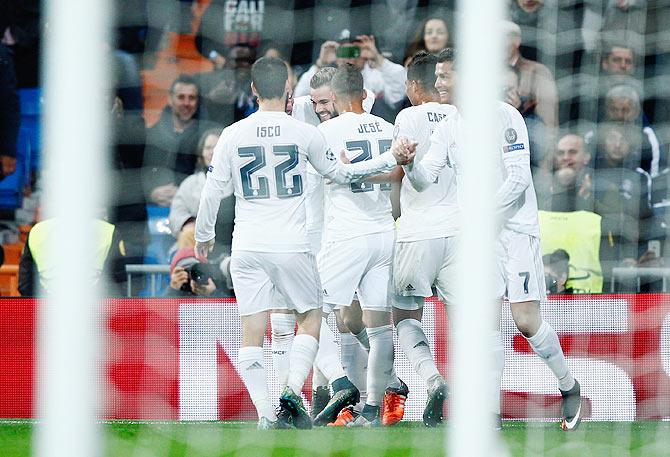 e5c435628 Real Madrid s Nacho Fernandez celebrates with teammates on scoreing their  first goal against Paris Saint-