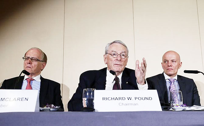 WADA Founding President and former IOC Vice President Richard W. Pound (centre) speaks next to Legal Counsel and member of the Court of Arbitration for Sport (CAS) Richard H. McLaren (left) and Head of Department Cybercrime with Bavarian Landeskriminalamt (LKA) Guenter Younger during a news conference