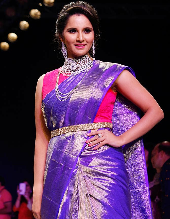 India's doubles tennis ace Sania Mirza walked the ramp during the India International Jewellery Week in Mumbai in 2015