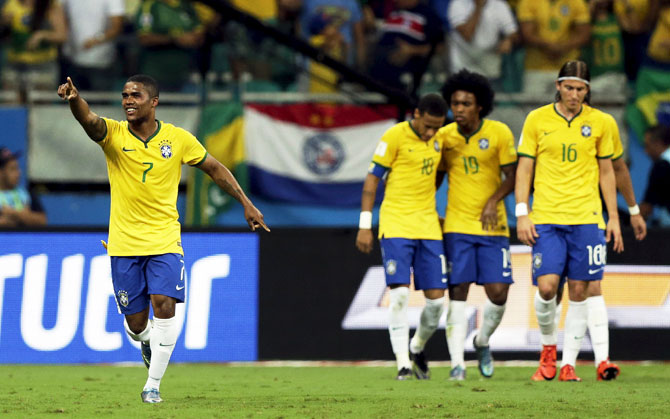 Brazil's Douglas Costa (left) celebrates a goal against Peru during their 2018 World Cup qualifying match in Salvador on Tuesday