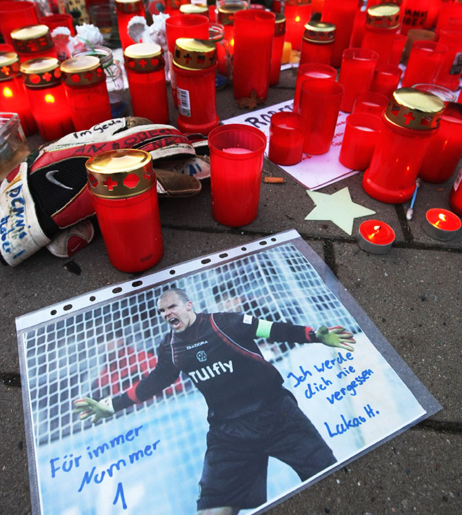 A hand-scrawled note that reads: 'I will never forget you. Forever Number 1' on a pictuire of deceased Hannover 96 goalie Robert Enke lies among a sea of candles before a memorial service prior to Enke's funeral at AWD Arena on November 15, 2009 in Hanover