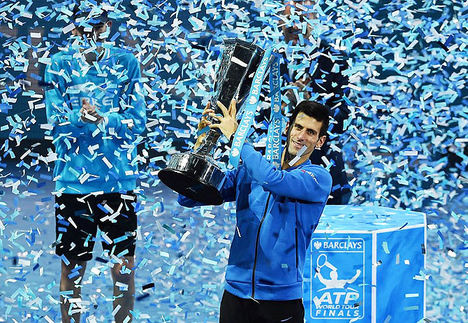 Serbia's Novak Djokovic celebrates with the trophy after winning the Barclays ATP World Tour Finals. He beat Switzerland's Roger Federer in the final at the 02 Arena in London on November 22