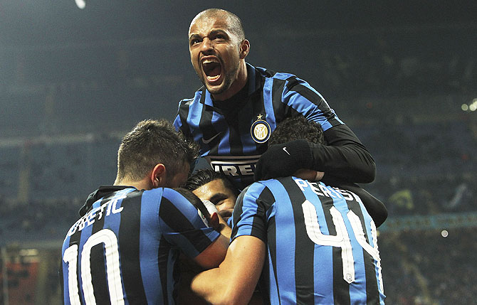 Inter Milan players celebrate a goal against Frosinone Calcio during their Serie A match at Stadio Giuseppe Meazza in Milan on Sunday