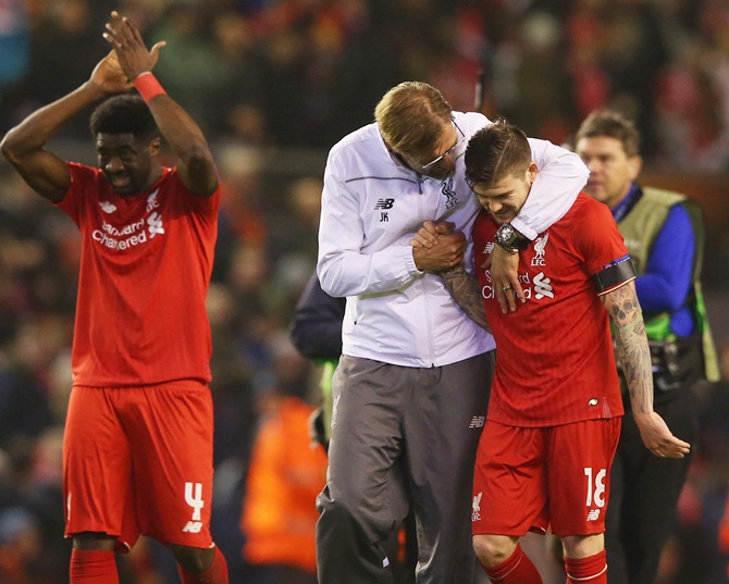 Jurgen Klopp manager of Liverpool embraces Alberto Moreno
