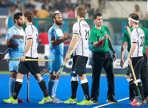 Indian and German hockey players
