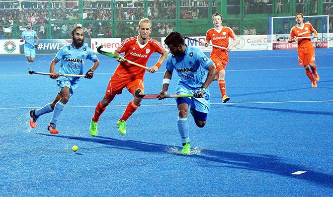 Indian and Dutch players in action during Hockey World League Final in Raipur