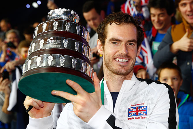 Andy Murray of Great Britain poses with his trophy following victory in the Davis Cup