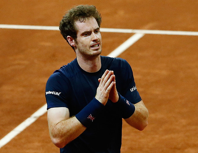 Andy Murray of Great Britain celebrates defeating David Goffin of Begium to win the Davis Cup during day three of the Davis Cup Final