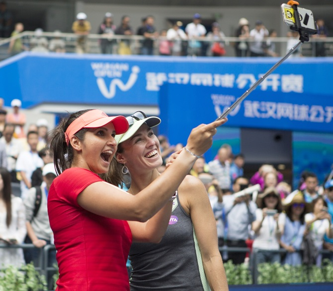 Rediff Sports - Cricket, Indian hockey, Tennis, Football, Chess, Golf - Wuhan Open: Sensational Sania and Hingis lift women's doubles title