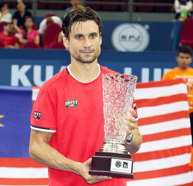 Rediff Sports - Cricket, Indian hockey, Tennis, Football, Chess, Golf - Malaysian Open: Ferrer beats Lopez to win title
