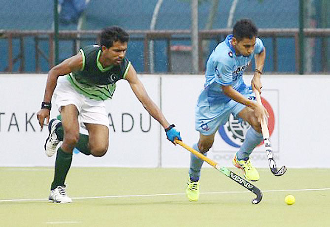 A player from India's Junior team and his Pakistani counterpart in action during the 5th Sultan of Johor Cup match in Johar Bahru, Malaysia, on Sunday
