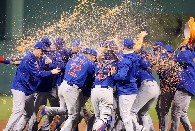 The Chicago Cubs celebrate after defeating the Pittsburgh Pirates in the National League Wild Card playoff baseball game at PNC Park on October 7