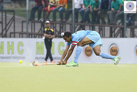 A junior India hockey player in action