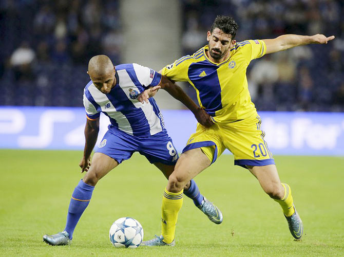 Porto's Yacine Brahimi (left)) fights for the ball with Maccabi Tel Aviv's Ben Harush during their Champions League group G match at Dragao Stadium in Porto, on Tuesday