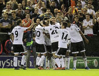 Valencia's players celebrate after they scored a goal against Gent during their Champions league Group H match at the Mestalla stadium in Valencia