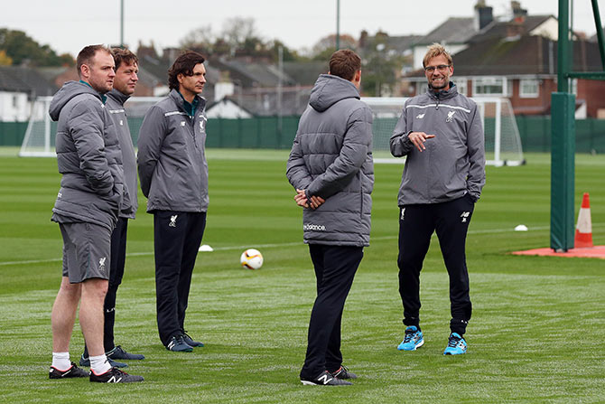 Liverpool manager Jurgen Klopp (right) makes a point to his assistants