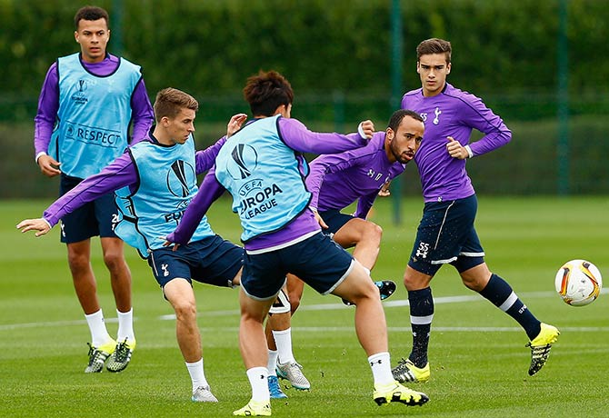Andros Townsend of Tottenham Hotspur (second right) passes the ball during a training session