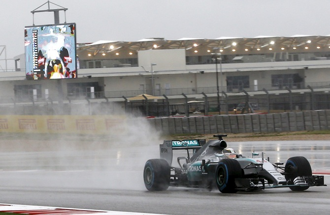 US Grand Prix: Hamilton fastest as fans shut out by rain
