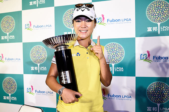 Lydia Ko of New Zealand poses with the trophy