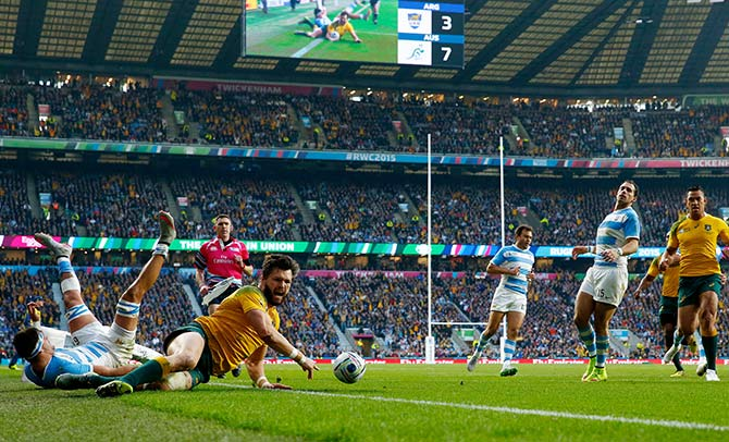 Adam Ashley-Cooper of Australia dives over to scores his sides second try