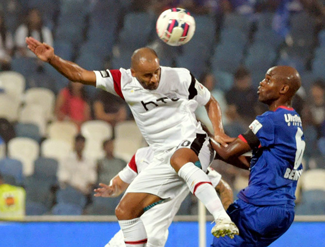 Mumbai City FC (Blue) and NorthEast United FC (White) players in action during the ISL