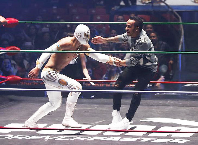 What fun! F1 champion Hamilton wrestles with Mexican culture