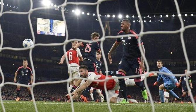 Olivier Giroud scores the first goal for Arsenal during their Champions League group match against Bayern Munich at the Emirates in London on Tuesday