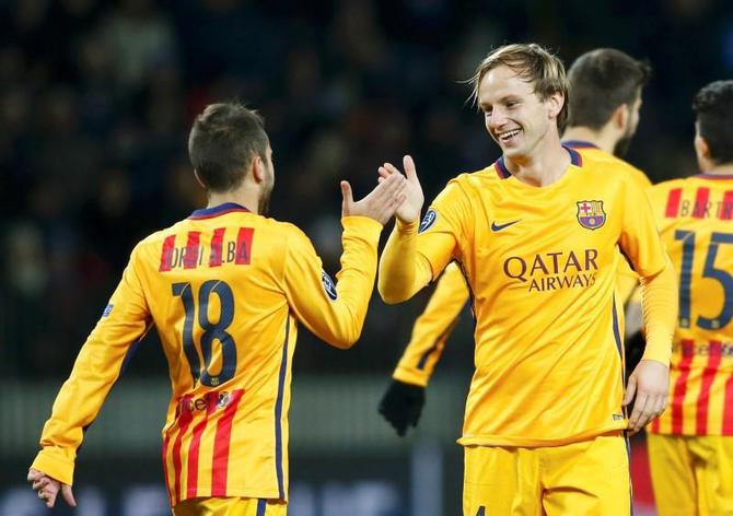 Barcelona's Ivan Rakitic (right) celebrates with teammate Jordi Alba after scoring against BATE Borisov during their Champions League Group E match at the Borisov Arena stadium outside Minsk, in Belarus, on Tuesday