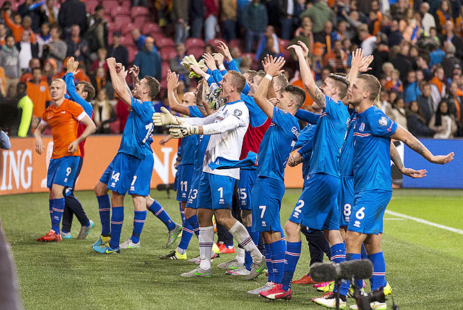 Iceland's team celebrate their victory over the Netherlands after their Euro 2016 qualifying match in Amsterdam, the Netherlands on Thursday