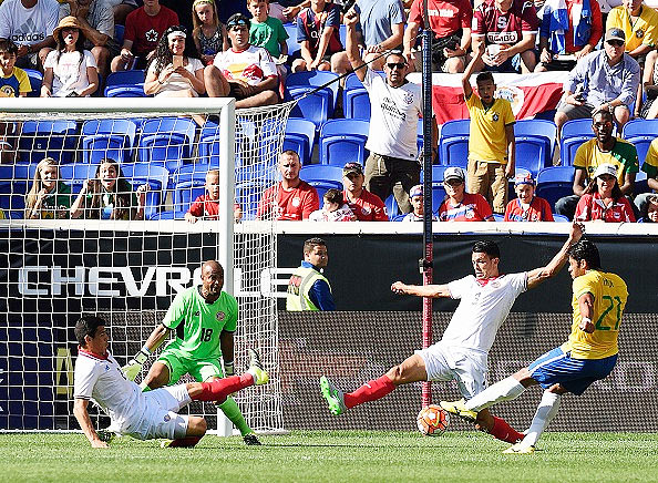 Brazil's Hulk (right) shoots to score against Costa Rica during a friendly at Red Bulls Arena in Harrison, New Jersey, on Saturday