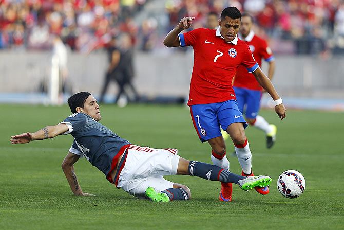 Paraguay's Gustavo Gomez (left) challenges Chile's Alexis Sanchez during their friendly match in Santiago, on Saturday
