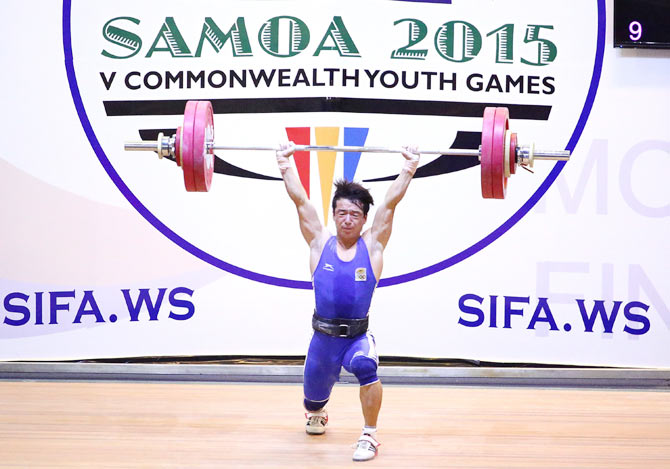 India's Jamjang Deru lifts during the Men 56kg A Weightlifting at the Tuanaimato Sports Facility on Day 1 of the Samoa 2015 Commonwealth Youth Games in Apia, Samoa, on Monday