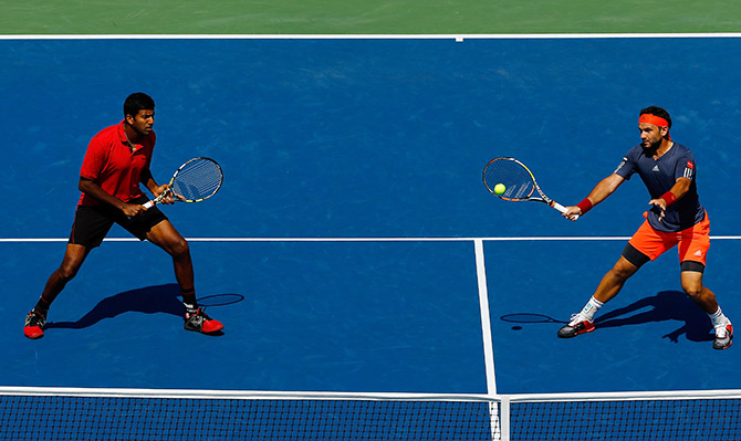 Rohan Bopanna of India and Florin Mergea of Romania in action at the US Open