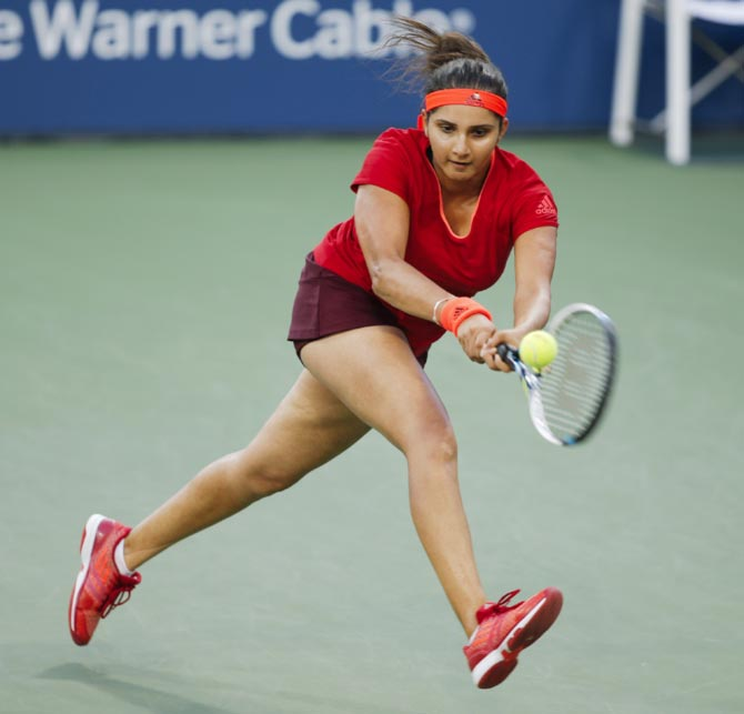 Rediff Sports - Cricket, Indian hockey, Tennis, Football, Chess, Golf - Sania continues to rule women's doubles rankings