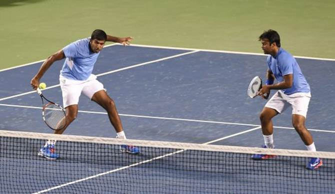 India's Rohan Bopanna (left) and Leander Paes in action