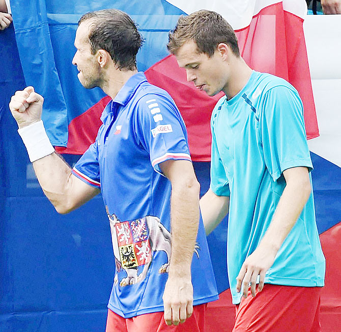 Czech Republics Adam Pavlasek (right) and Radek Stepanek celebrate after winning their doubles tennis match against India's Rohan Bopanna and Leander Paes during the second day's play at the Davis Cup World Group play-off tie in New Delhi on Saturday