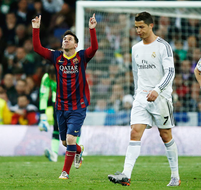 Lionel Messi (left) of Barcelona celebrates next to Real Madrid's Cristiano Ronaldo