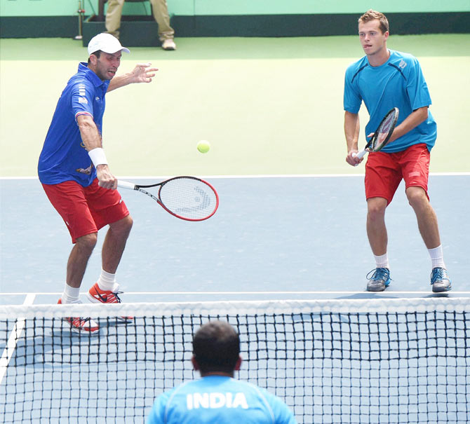 Czech Republic's Adam Pavlasek (right) and Radek Stepanek in action against India's Rohan Bopanna and Leander Paes during their doubles tennis match at the Davis Cup World Group play-off tie in New Delhi on Saturday